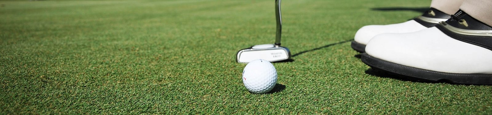 Close up view of a golfer putting