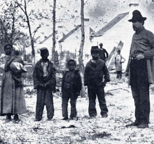 Mitchelville family with a Union soldier, circa 1861.