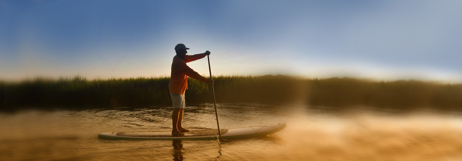 Man riding a paddleboard