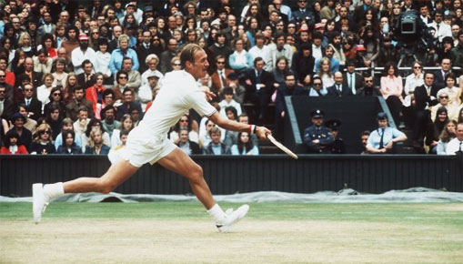 Stan Smith reaching for a ball