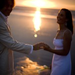 Newly weds on the beach at sunset