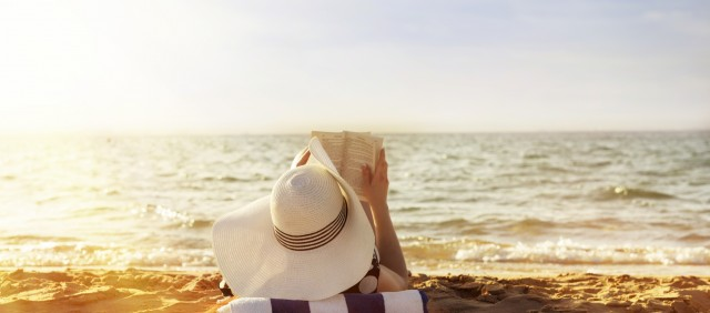 reading on the beach woman