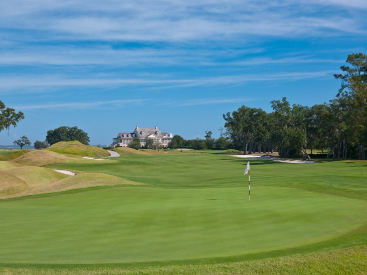 The Dye Course clubhouse and 1st hole at Colleton River