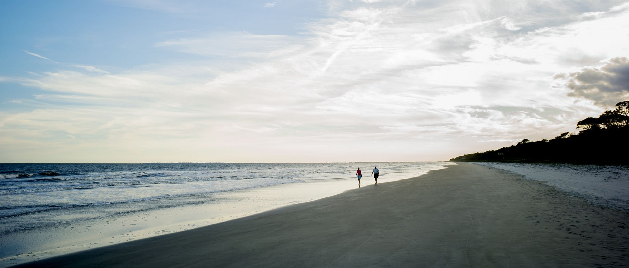 Couple walking along the beach