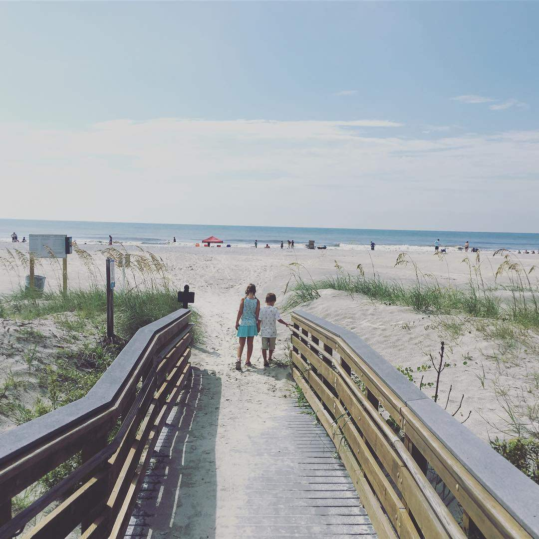 A brother and sister walking to the beach on Hilton Head Island