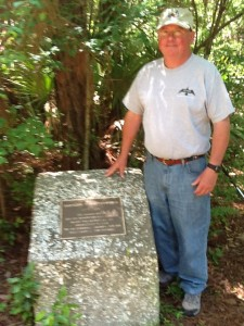 Jack Greenshield standing next to monument