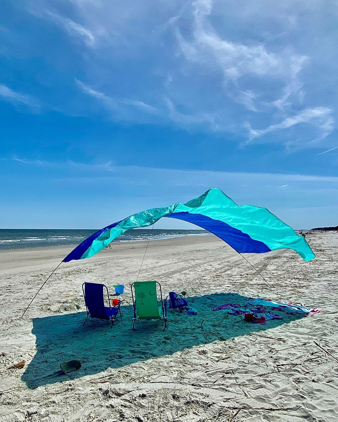 Beach chairs and canopy on beach