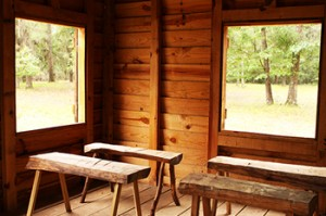 Inside the rustic wood cabin
