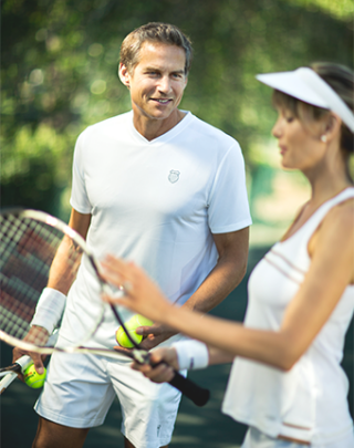 A couple playing tennis.