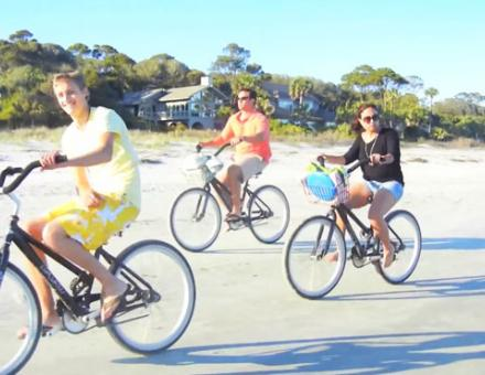 A group of people biking on the beach