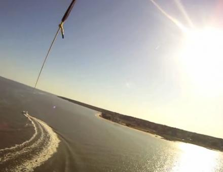View of the water from a person parasailing