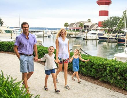 A family walking, holding hands at the Sea Pines Resort