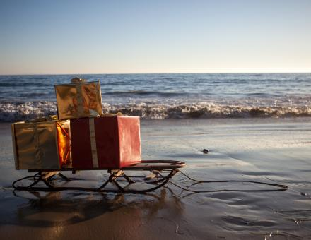 Sleigh with gifts on beach