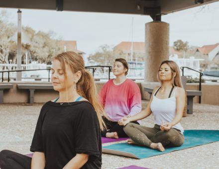Join us on the marina front covered pavilion for morning yoga!
