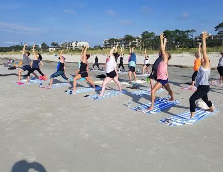 Yoga on the beach every Friday and Saturday morning throughout the summer in Hilton Head Island at the Beach House Resort.