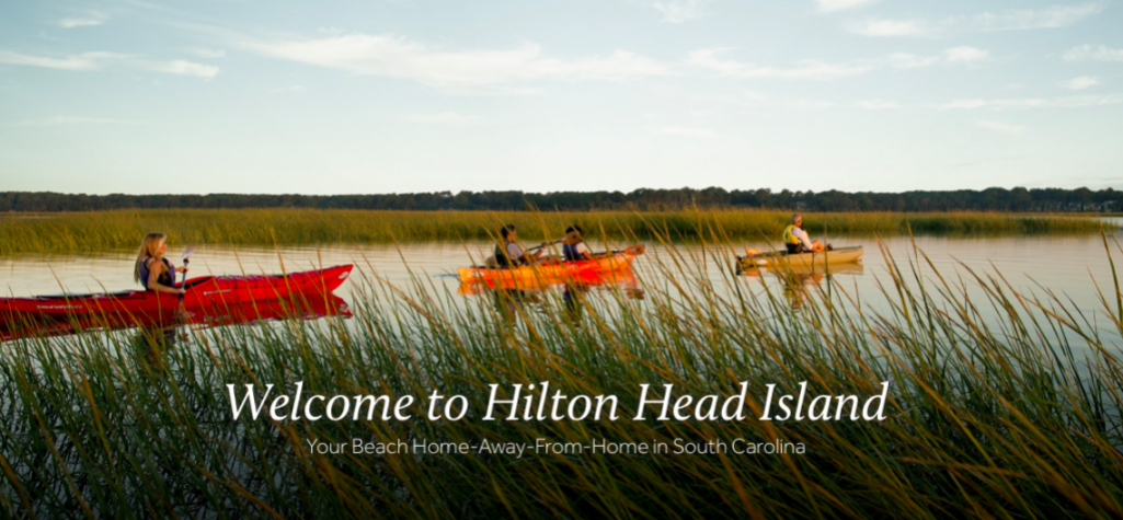 Welcome to Hilton Head Island, people kayaking on lagoon