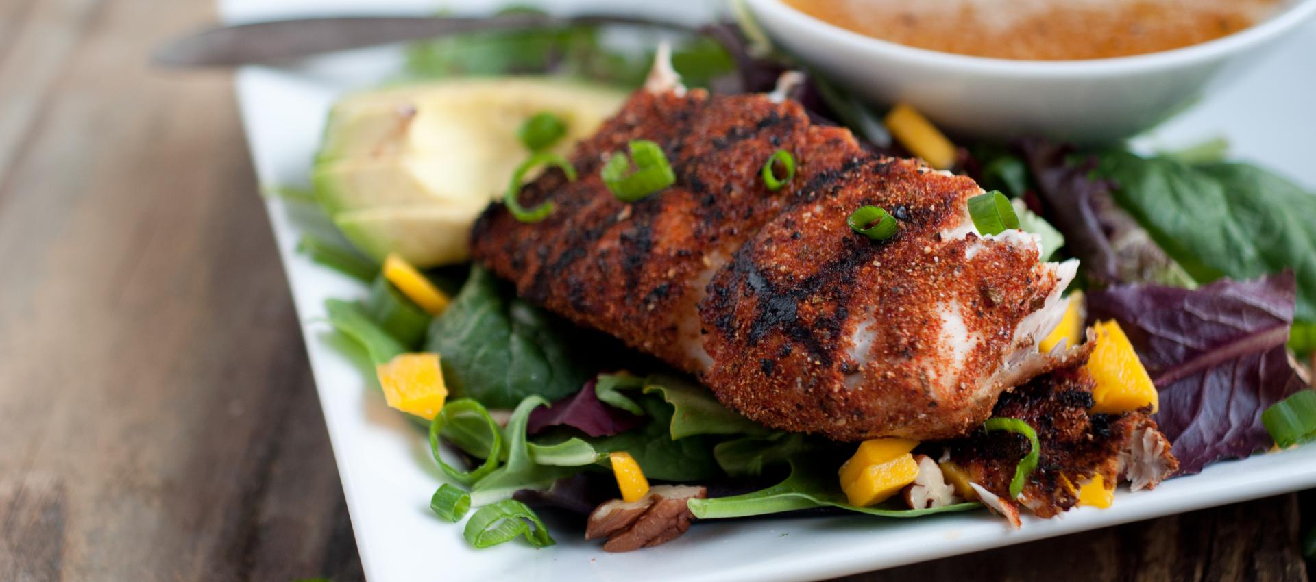 blackened mahi mahi on salad