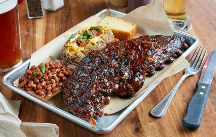 Ribs, beans, and loaded baked potato