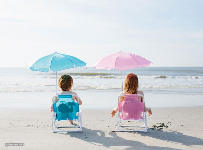 Two children sitting on the beach