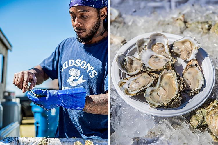 man shucking oyster