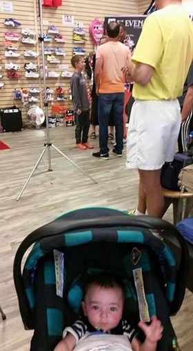 Baby in stroller with line behind hi