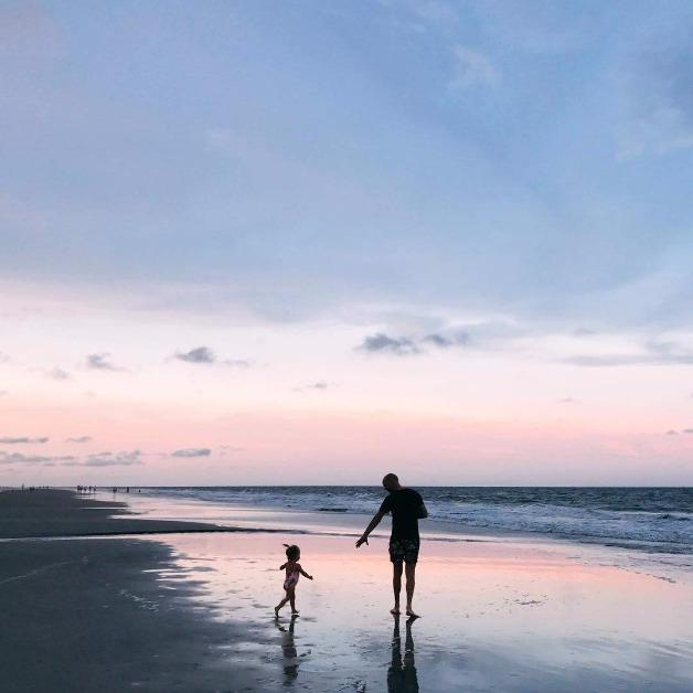 a father and daughter on the beach