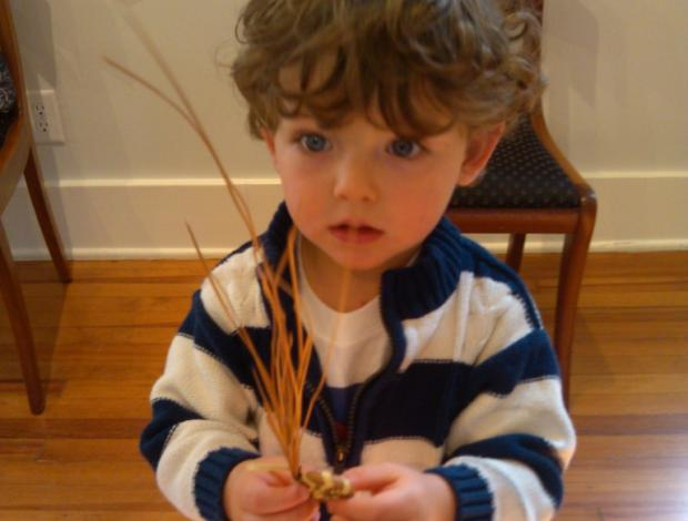 Young boy with sweetgrass