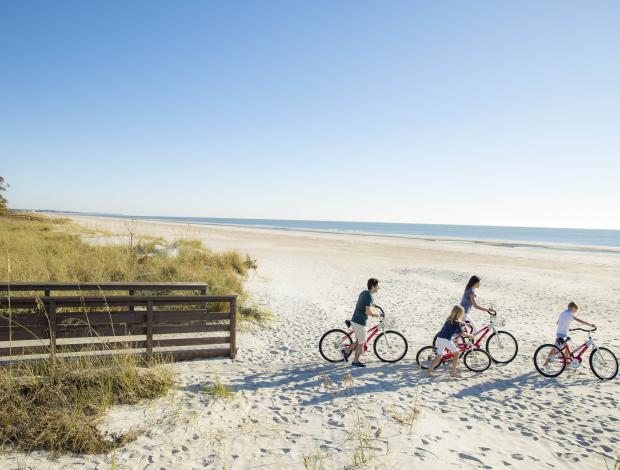 Family biking on Hilton Head Island Beach