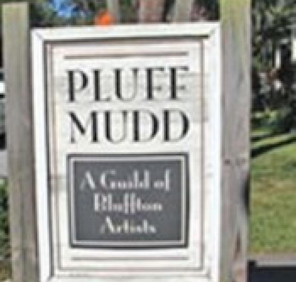 "Sign reading, ""Pluff Mudd."""
