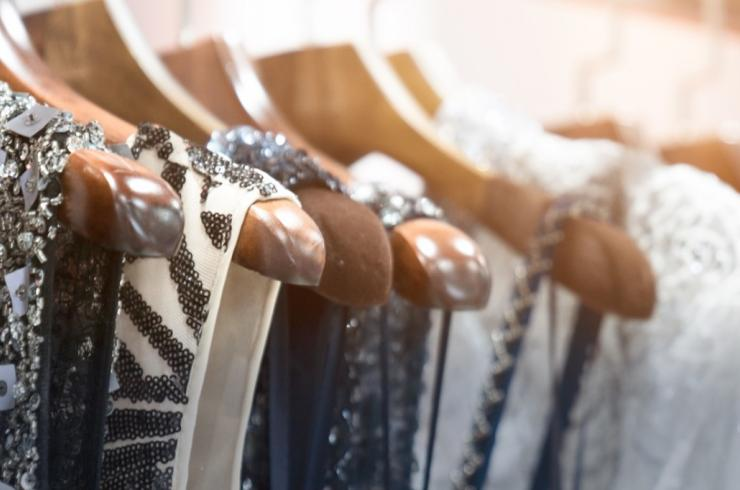 A rack of sparkly dresses hanging on hangers