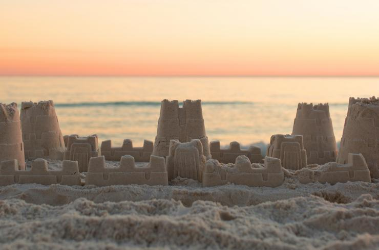 Intricate sandcastle at sunset