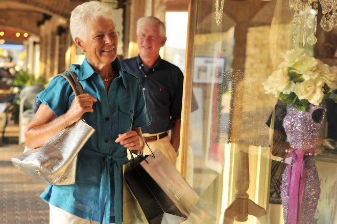 An elderly couple window shopping at Shelter Cove