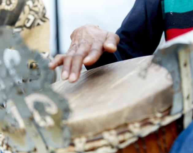 A hand playing the drum