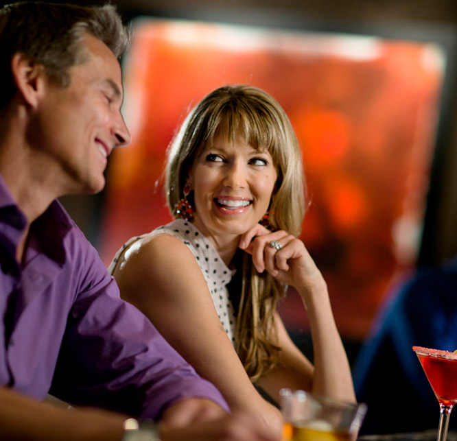 Man and woman chatting in a club
