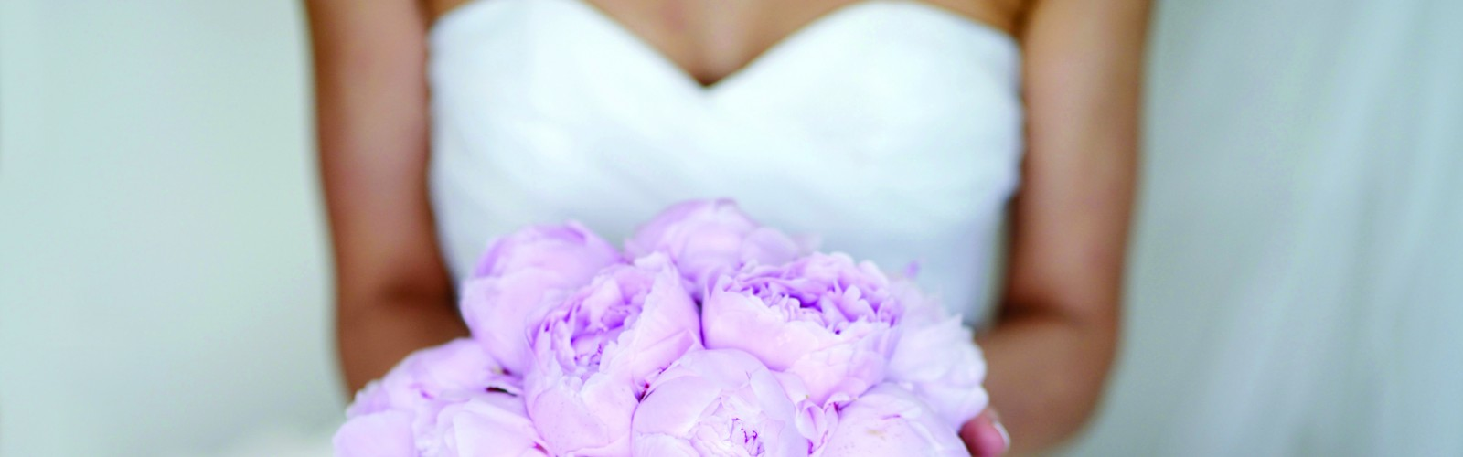 A Bride with her bouquet at one of our destination weddings in South Carolina