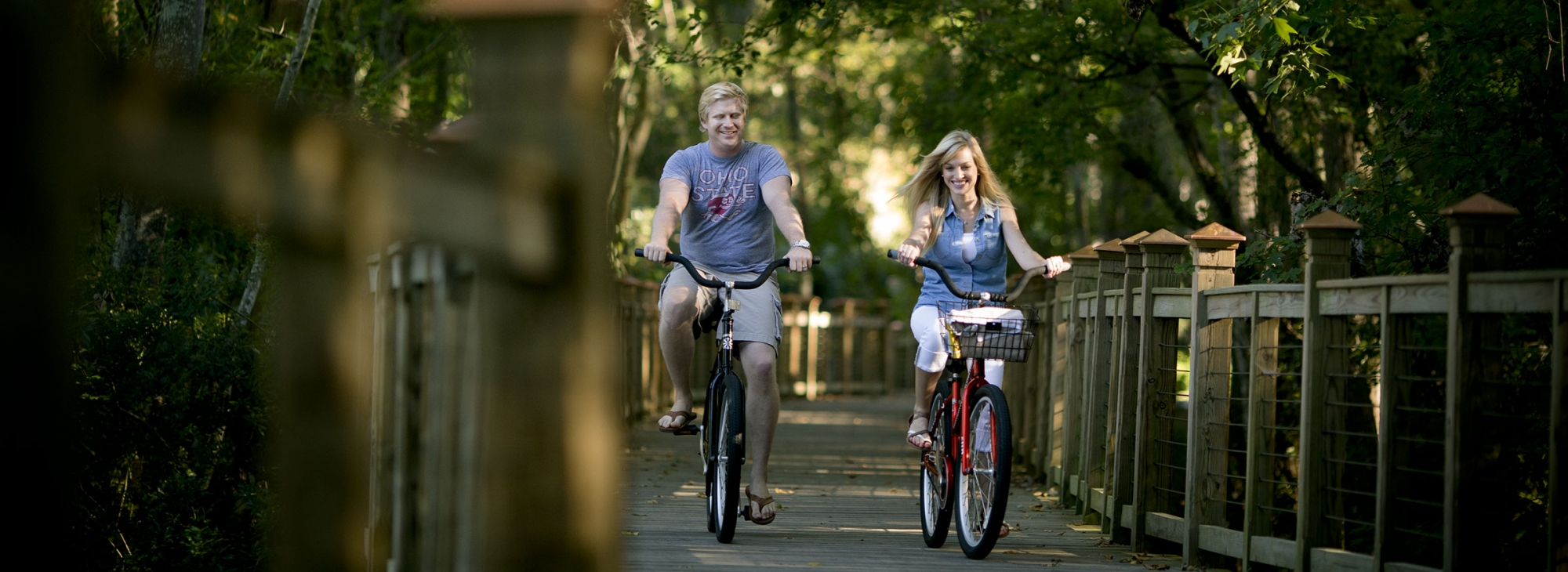 Couple riding bikes along a path