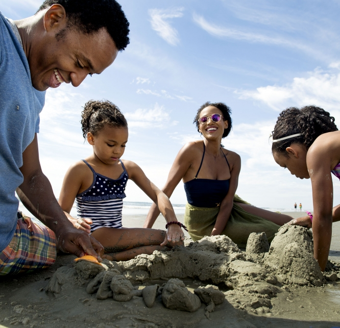 Family playing in the sand - South Carolina Family Vacation