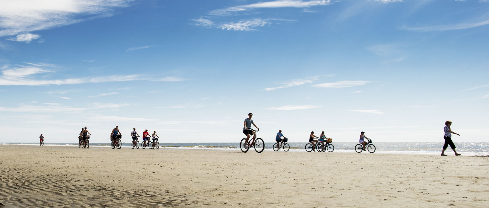 Groups of cyclists on the beach