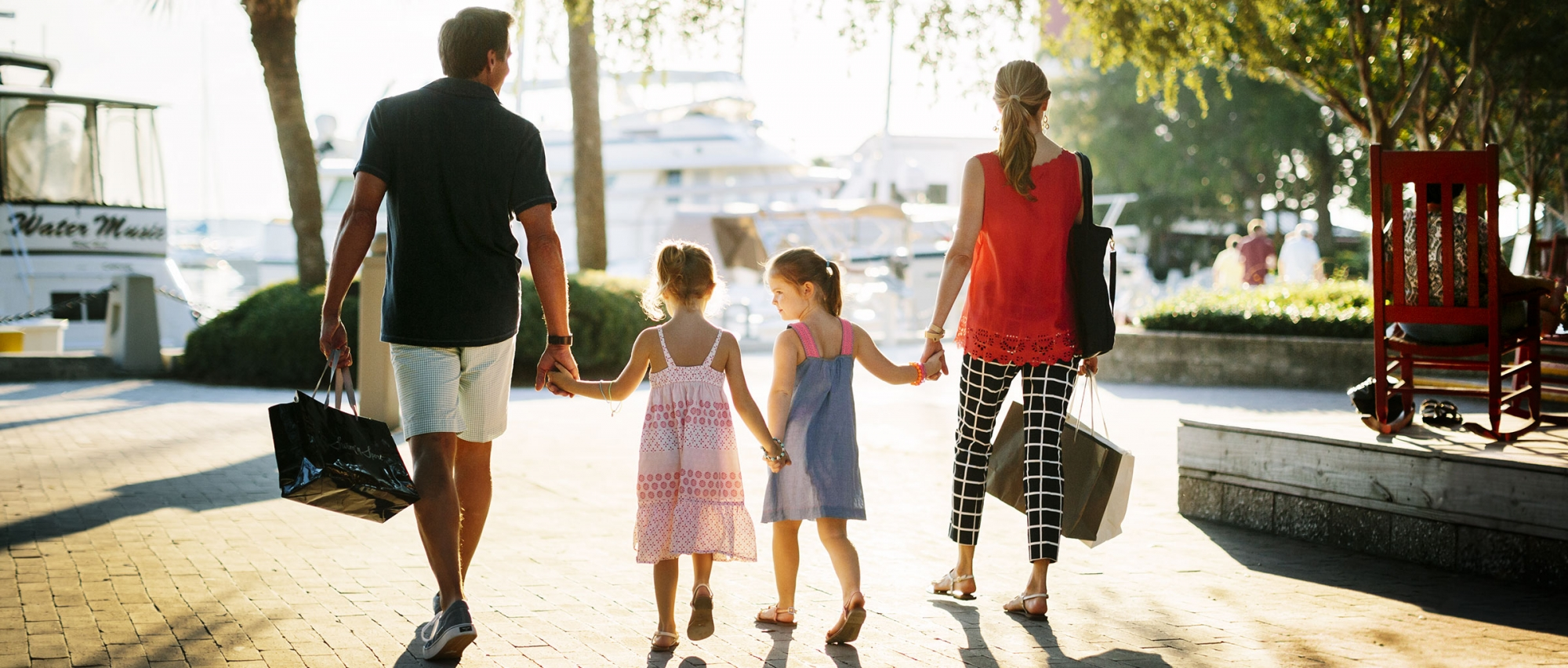 Family walking with shopping bags