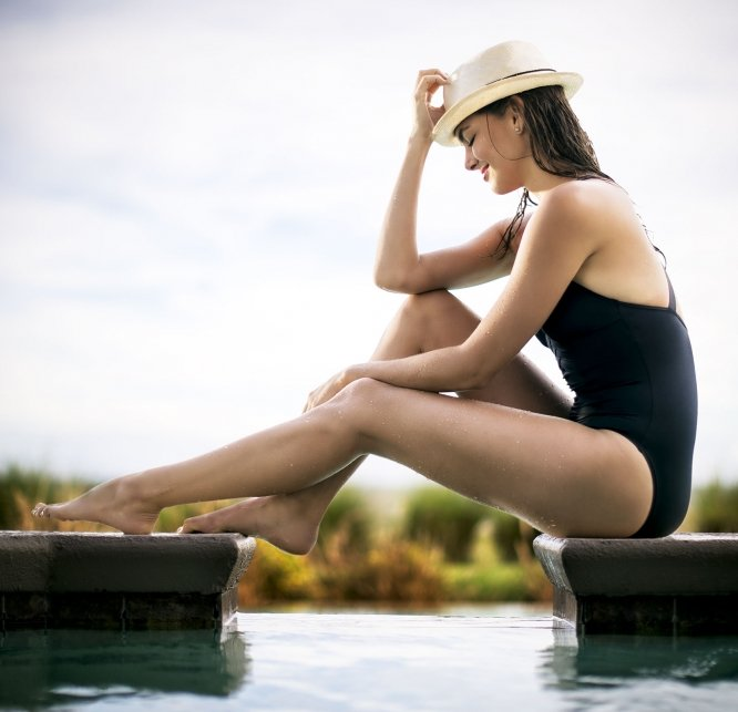 Woman relaxing by a spa pool