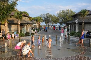 Children playing in the Coligny Park Beach fountain