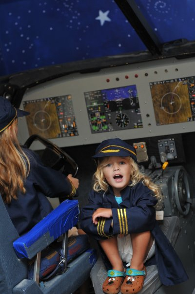 Kids playing in the realistic flight cockpit