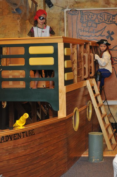 Kids playing on a pirate themed playset