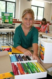 Young girl picking out colored pencils