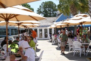Patrons enjoying the patio at The Salty Dog Cafe