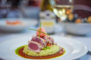 Seared Ahi Tuna with a sesame crust served with edamame hummus, vegetable slaw, pickled ginger and ponzu from CQ's.