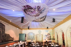 The lovely main dining space at Trattoria Divina is indeed divine with hand-painted murals by students from the Savannah College of Art & Design and a billowy ceiling floating above. Photo: W Photography