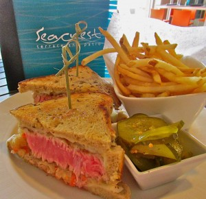 The Tuna Reuban layered on a bed of crunchy citrus coleslaw on tasty rye, served with crispy fries and Chef's excellent homemade pickles.